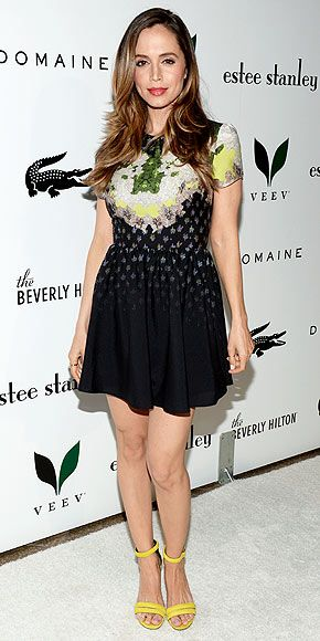ELIZA DUSHKU Also stepping out in yellow shoes at the same event (take note, trend watchers), Eliza pairs her ankle-strap sandals with a flirty black embroidered dress.
