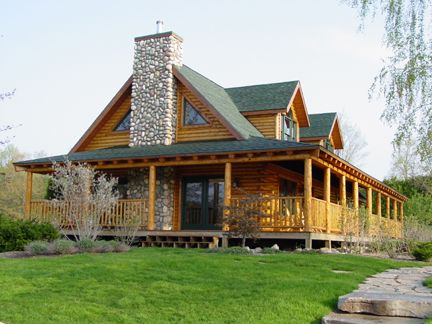 Love the wrap around porch on this pretty log cabin. :)