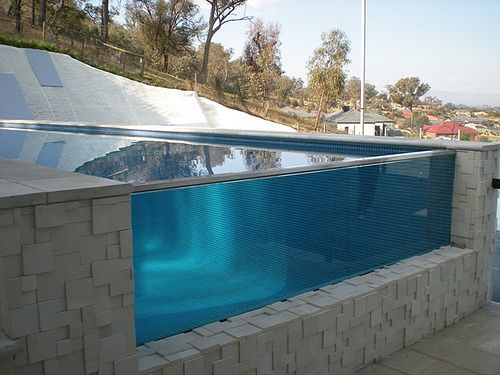 11 best glass pools images on pinterest glass pool pools and swimming pools for Glass swimming pool walls cost