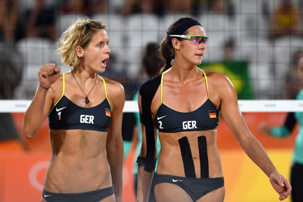 Laura Ludwig (L) and Kira Walkenhorst of Germany react during the Women's Beach Volleyball preliminary round Pool D match against Nada Meawad and Doaa Elghobashy of Egypt on Day 2 of the Rio 2016 Olympic Games at the Beach Volleyball Arena on August 7, 2016 in Rio de Janeiro, Brazil.