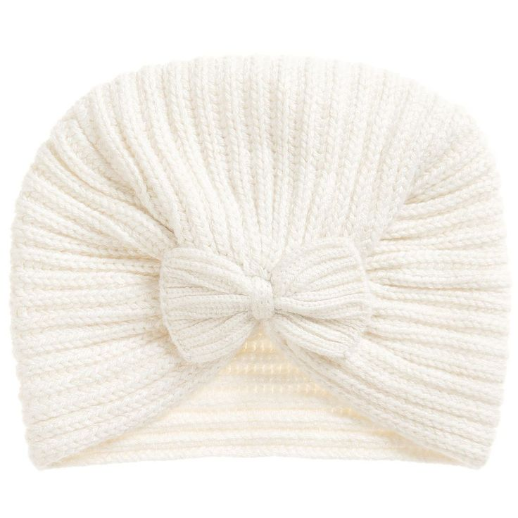 This ivory, cable-knit turban by Lili Gaufretteis just what a girlneeds when it's chilly outside. Madeina soft viscose, cotton and wool blend with glittery gold thread, it is both cosy and sparkly, a perfect combination.
