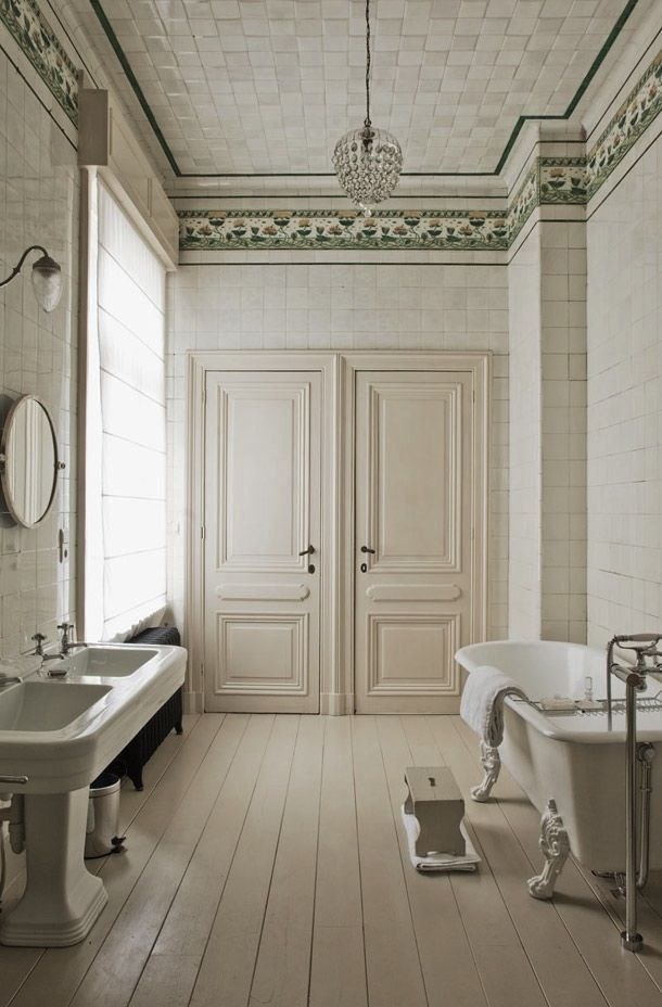 Elegant neutral color classical bath, claw foot tub, marble ceiling, old world charm