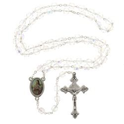 A St. Maria Goretti rosary featuring clear crystal beads, a symbol of her purity.