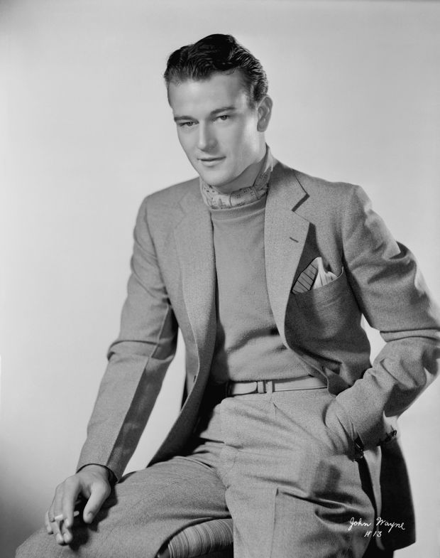 John Wayne did not serve in World War II, even though he portrayed the ideal American hero and appeared in the Pacific for a USO tour during the war. Description from biography.com. I searched for this on bing.com/images