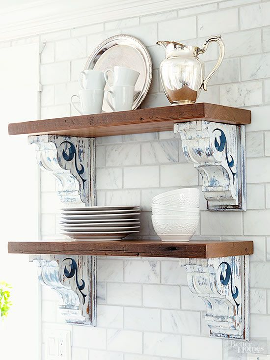 Wood shelves paired with painted and distressed corbels provide pretty display shelving. Look for the scrolling brackets at flea markets and secondhand stores for beautiful budget storage with cottage style./