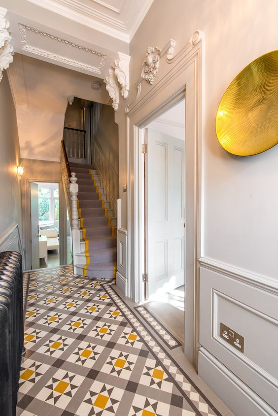 Grey and yellow #entryway #hallway. Love the beautiful modern take on Victorian floor tiles with coordinating #stair runner
