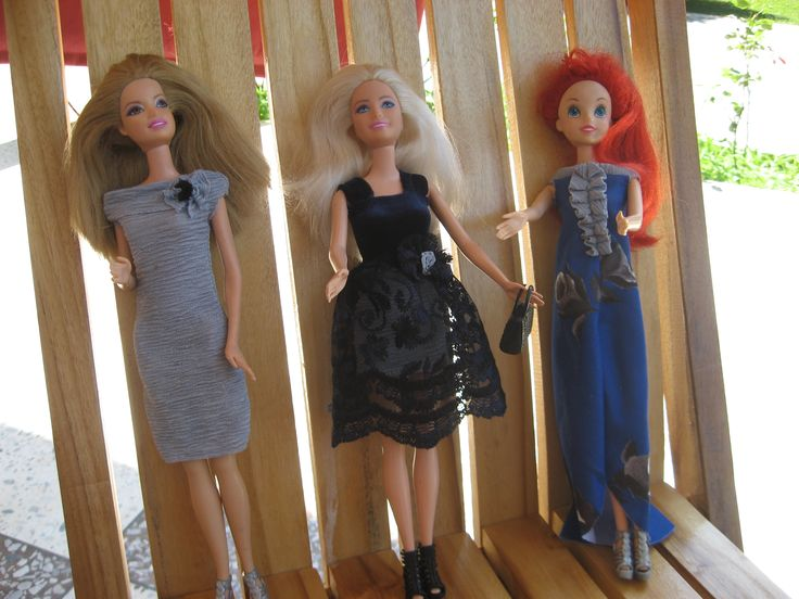 Old barbie dolls in a new dresses.