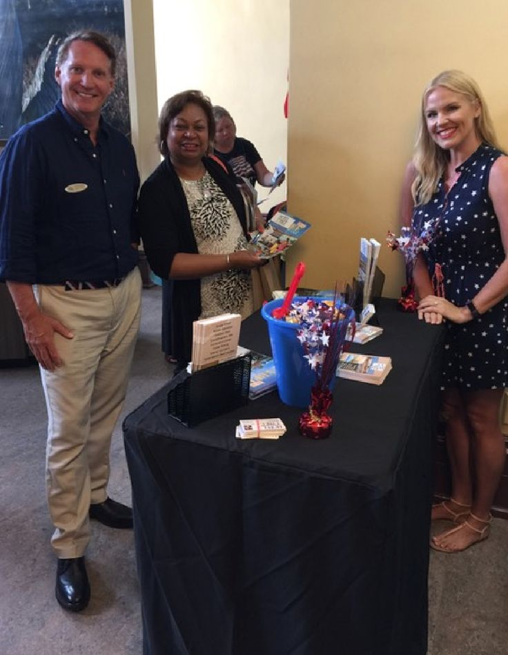 Curry Nicolini and David Thomas from the newly-renovated Tybee Hotel stopped by the Savannah Visitor Center at MLK and met Miranda McKenzie from Atlanta who's organizing a 200-person family reunion in Savannah next year.