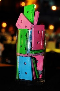 Centerpieces. Buy casette tapes a goodwill and spraypaint them neon colors.