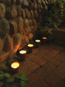 Lighted clay pots in the garden