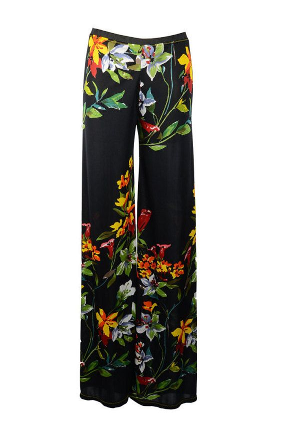 Headed to Rio for the Olympics or on jaunt to the Riviera for a romantic getaway? Get these silk resort pants that are bright, breezy, breathable, and beautiful! A rainbow of large flowers in brilliant red, orange, yellow, white, green, and light blue on black for a stand-out effect, with the bouquet bearing a painted-on look.    Easy to pack as well as comfy to wear on long flights and running between airport gates, these are the perfect pants for your next vacation. Or lounge around in…