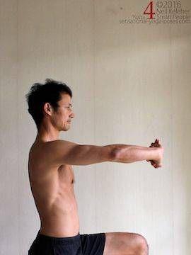 Arm overhead shoulder stretch, hands clasped and palms pressing upwards, neil keleher, sensational yoga poses.