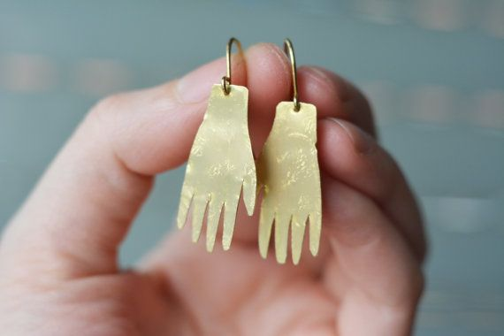 This is a golden colour brass earring made to order in my studio. The one on the pictures was sold, but a similar one can be made for you in 1-3 days after purchase! This pair was inspired by the earrings of the painter Frida Kahlo, who was best known for her brave self portraits. The white hand earrings were one of her favourite earrings to wear and can be seen on some of her work.  I made these earrings out of solid brass sheet with brass earwires. I HAVE STERLING SILVER EARWIRES available…