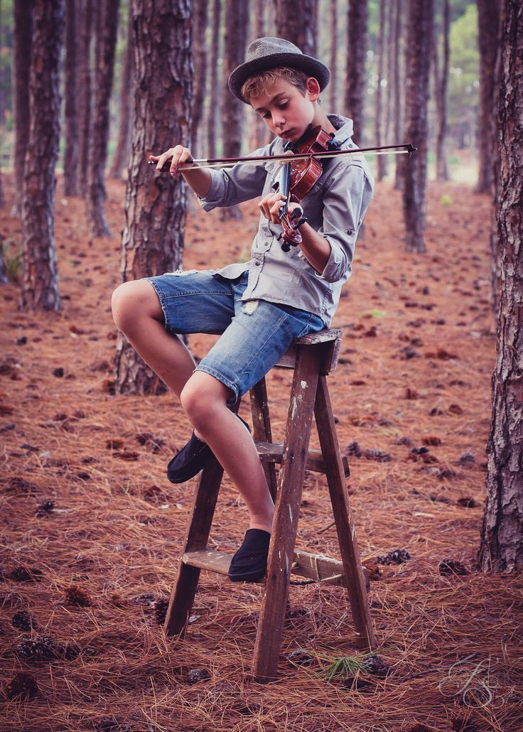 Saxon playing the violin.  Family Outdoor Photography