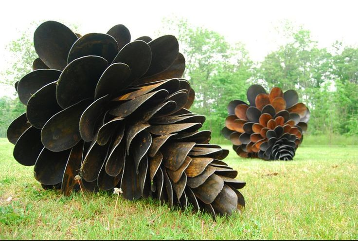 Old shovels are arranged into clever conifer cone sculptures.   By artist, Patrick Plourde