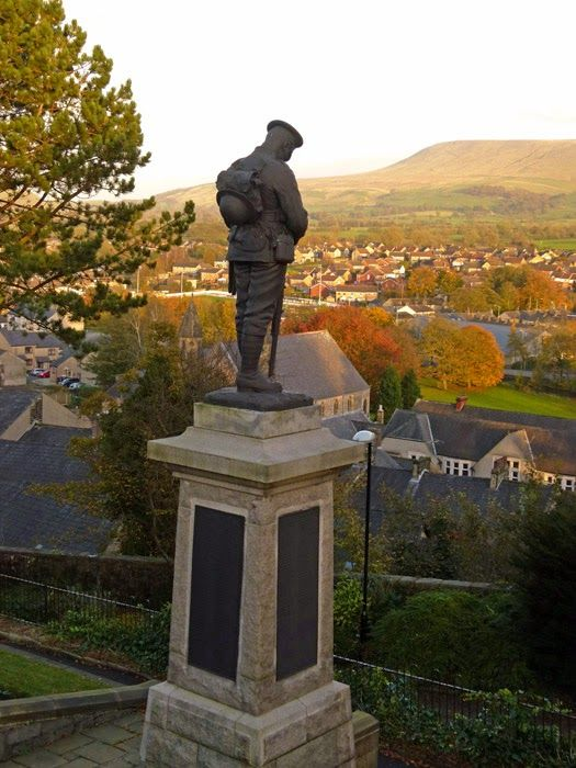 Clitheroe's war memorial stands guard over the town, looking toward Pendle Hill, Lancashire, England