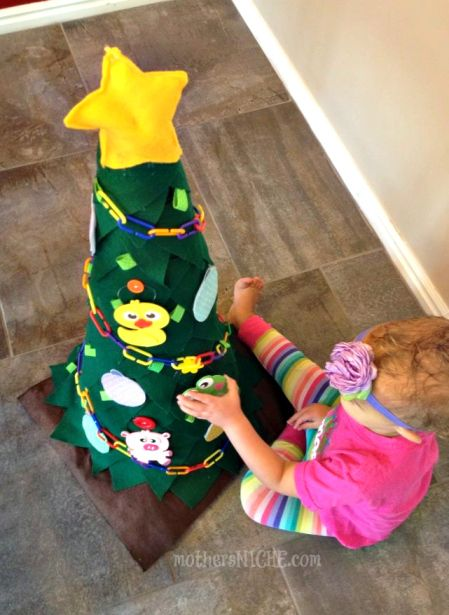 """Christmas tree for toddlers to decorate over and over - felt ornaments stick to this flannel """"tree"""". Clever use of a traffic cone to get the perfect size and shape!"""