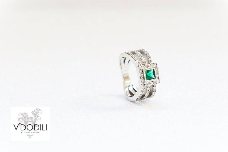 Princess cut Emerald and 62 small Diamonds set in Palladium