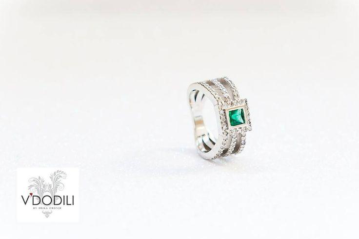Princess cut Emerald and 62 small Diamonds set in Palladium
