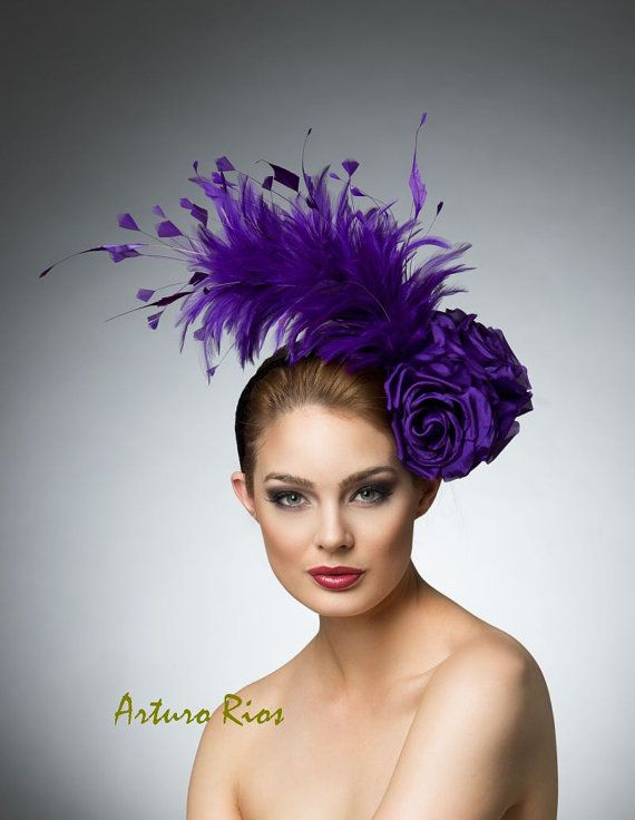 The new collection is here....!  This Gorgeous purple fascinator is made of rooster feathers and 4 silk roses, seated on a velvet headband, it can be
