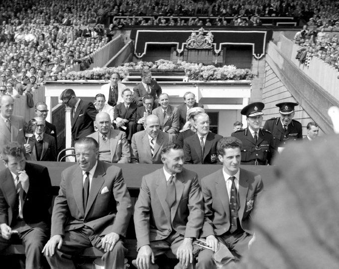 """Manchester United's Matt Busby watches his """"Babes"""" play Bolton in the 1958 FA Cup Final at Wembley just three months after the Munich air disaster. Far left on the front row is Busby's assistant Jim Murphy, the man responsible for almost single-handedly rebuilding the decimated United team"""