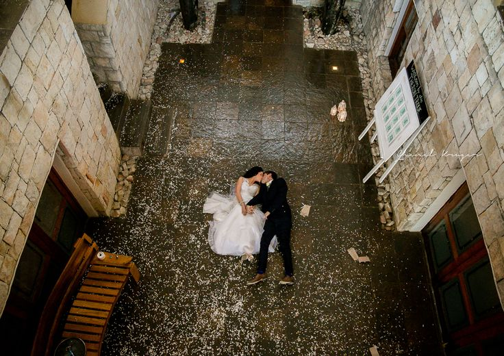 Bride and groom having a romantic moment in our stone quad
