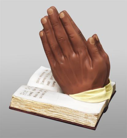 Beautifully painted figurine of a Praying Hands that set atop a bible.