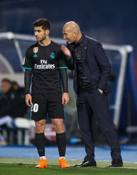 Zinedine Zidane, Manager of Real Madrid has a word with Marco Asensio of Real Madrid during the La Liga match between Leganes and Real Madrid at Estadio Municipal de Butarque on February 21, 2018 in Leganes, Spain.