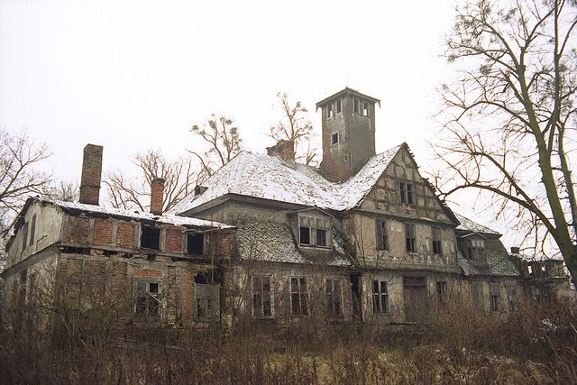 Abandoned 18th century manor house, front view. Lopuchowo, Poland.