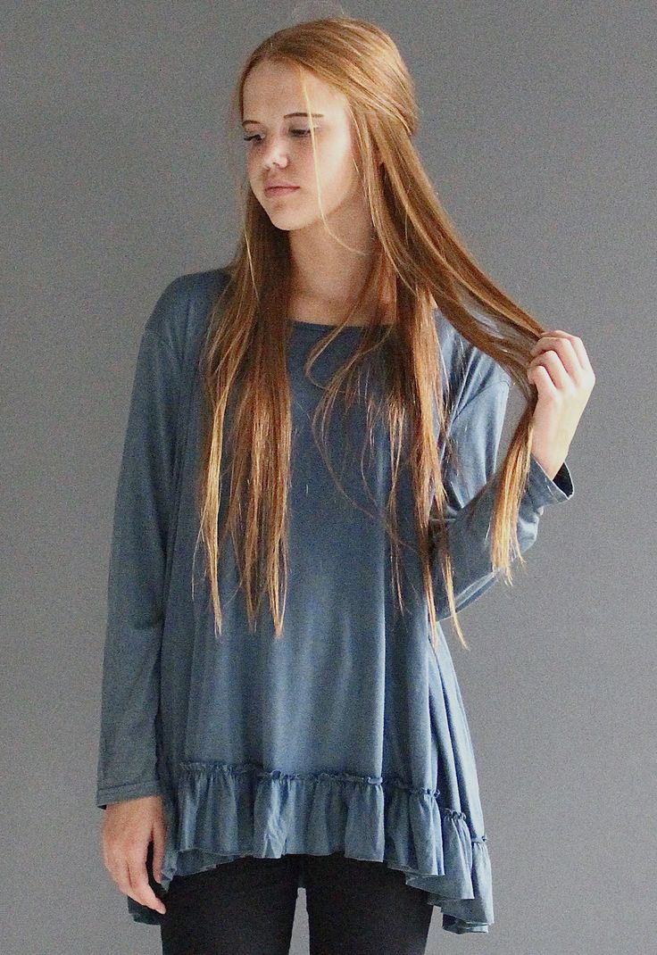 "Acid washed long-sleeve top that is perfect for your best day out. Ruffle edge that is longer in back and swing tunic style. - 70% cotton, 30% rayon - Model is 5'8"" wearing size Small - Available in B"