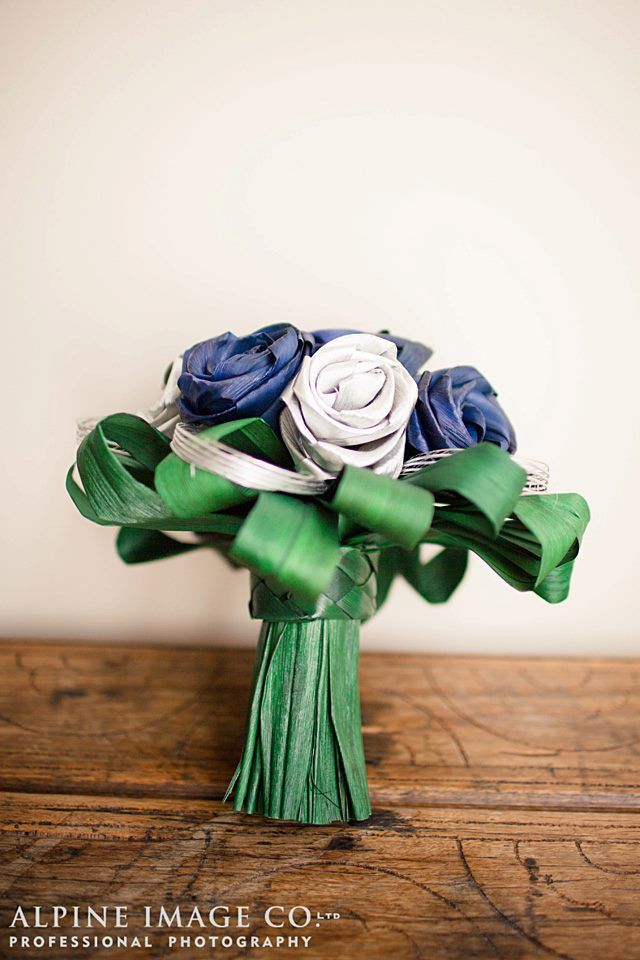 Spectacular wedding bouquet with silver and blue flax flowers surrounded with green flax foliage.  By Artiflax