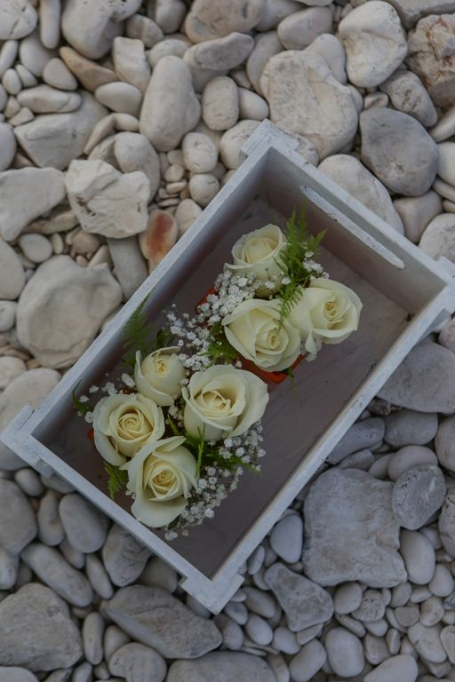 Small cute buttonholes of the groom and best men - white roses #weddingflowerideas #weddingingreece #mythosweddings #kefalonia