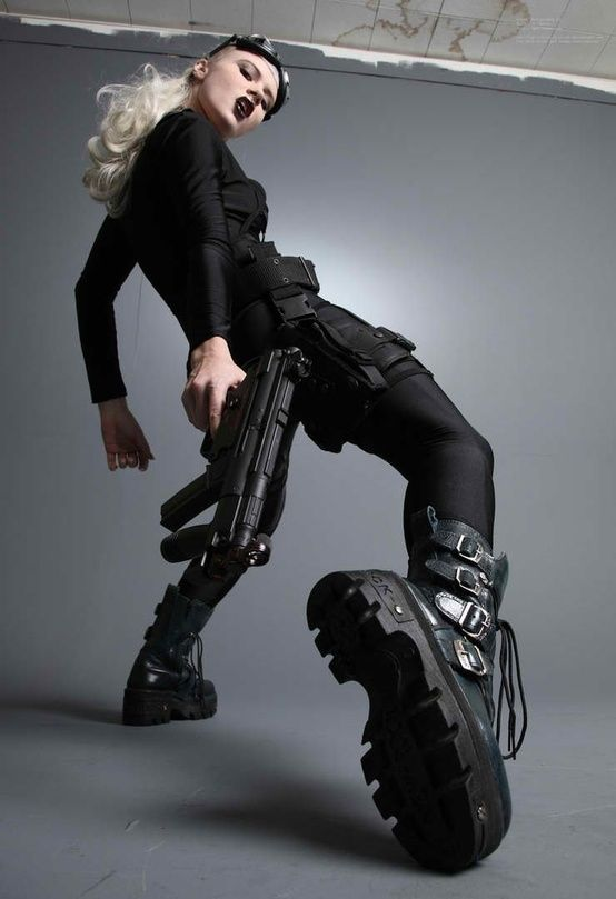 future, futuristic, cyberpunk, urban style, future girl, girl with gun, girl in black, future warrior, weapon, girl warrior, cyberpunk girl, by FuturisticNews.com
