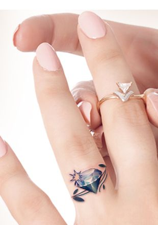 Diamond tattoo on ring finger