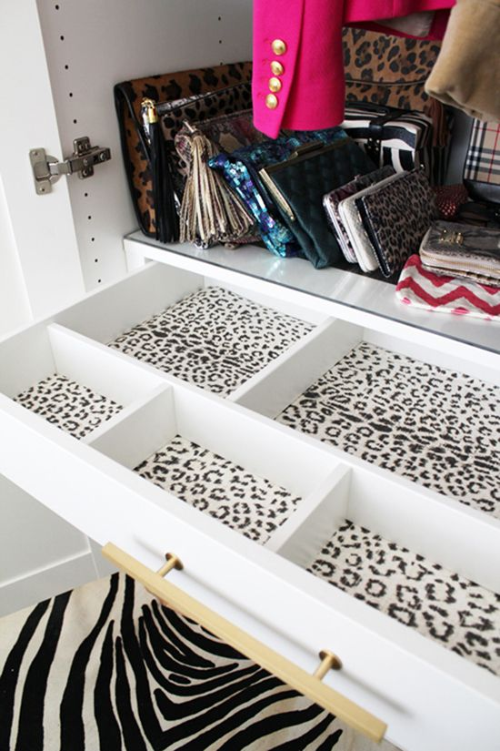 Amazing Closet Vignette With Collection Of Clutches, Ikea Pax Wardrobe,  Wallpaper Lined Drawers And Zebra Rug.