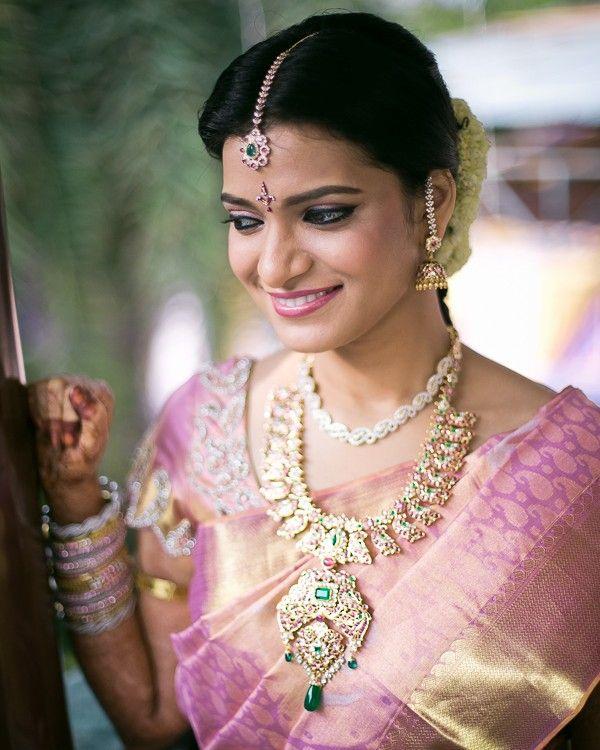 South Indian bride. Diamond Indian bridal jewelry. Jhumkis.Baby Pink silk…
