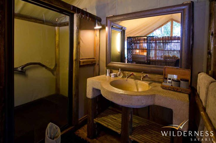 Tubu Tree Camp - En-suite bathroom facilities and an outdoor shower are standard. #Safari #Africa #Botswana #WildernessSafaris