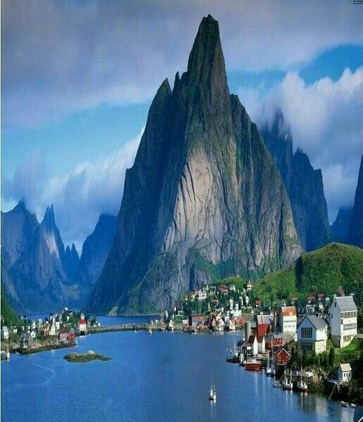 Reine, Norway: North of the Arctic Circle, Reine is a pretty fishing village in the Lofoten archipelago, an area of starkly beautiful Nordic wilderness, where sapphire bays punctuate fjords and mountains.
