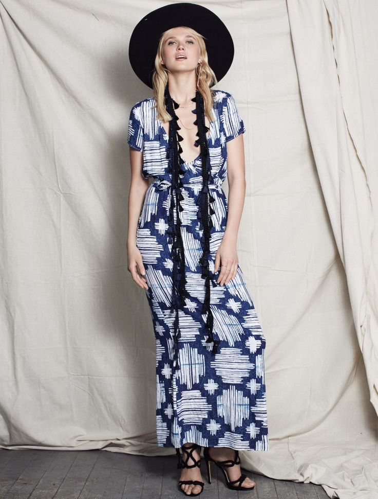 STEVIE MAY IKAT MAXI DRESS from the First Bright Collection. This fluid maxi dress drapes softly on your frame, with short capped sleeves and a wrap effect top that creates an alluring deep v-neck. In rich denim hues this organic abstract print is cut to create a loose yet slim fit. Gathered at the waist, use the self tie belt to define your shape. Available www.steviemay.com.au