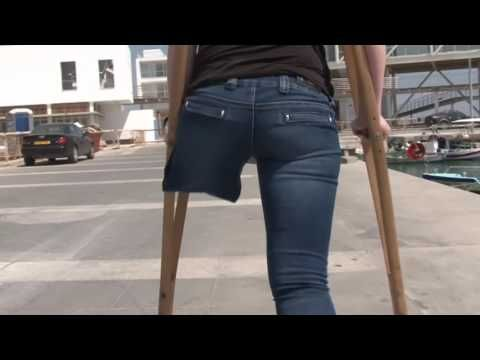 One-legged amputee lady crutching 02 - YouTube