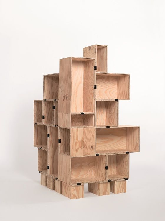 crates held together with croc clips... looks great! cheap, innovative and easy to adapt to different uses when you move as you can take it apart and reconstruct as needed! also great for awkward spaces...