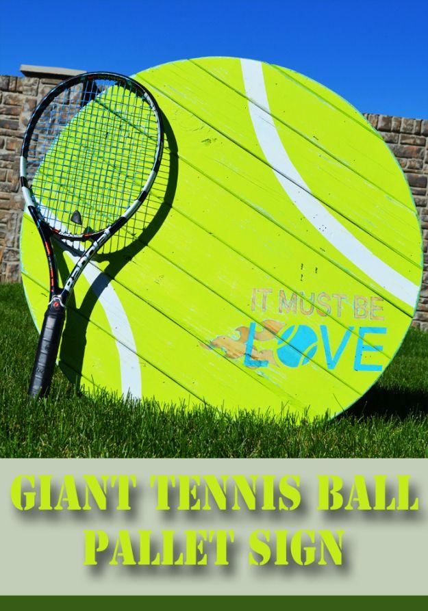 I 'LOVE' tennis.  Giant tennis ball pallet sign @hertoolbelt #tennisdecor #tennis