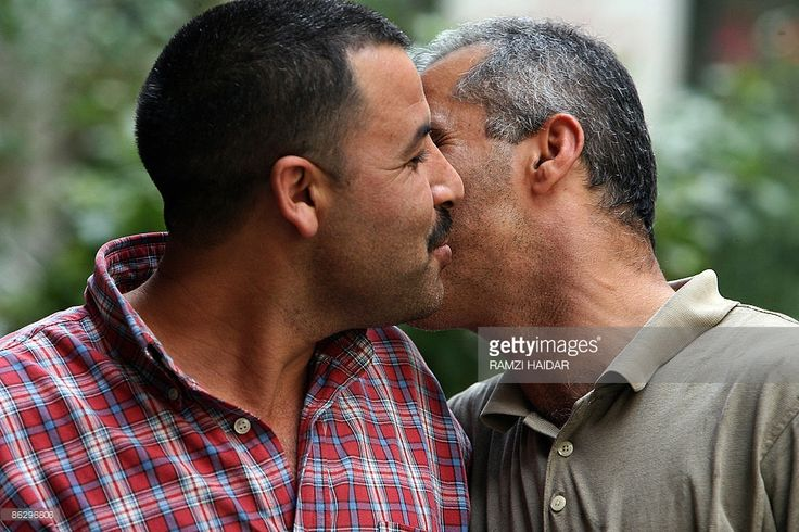 Lebanese men greet each other with a kiss on the cheek in Beirut ...