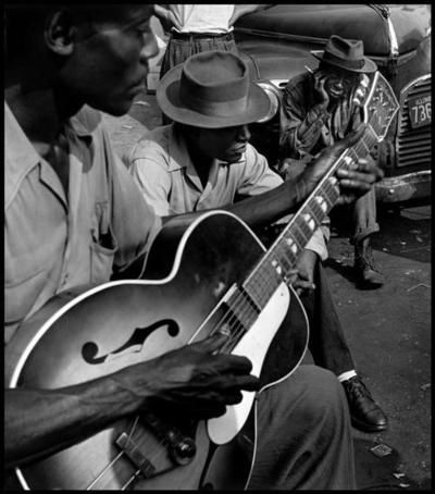Wayne Miller's Blues at the Maxwell Street flea market. Chicago, Il 1947....