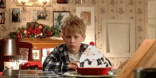 Macaulay Culkin as Kevin McCallister in the Home Alone movie partying with a delicious everything-on-it kind of sundae. Want to make something like this sundae? Then check out this Home Alone movie inspired recipe.