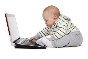 "Rudimentary   The baby is using a laptop, making it look like a laptop is easy to use or it's ""basic"" to use"