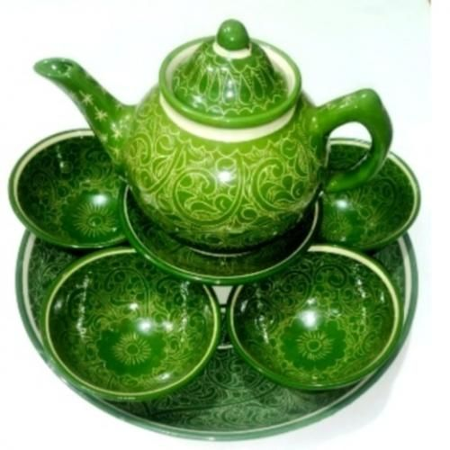 """Green Tea Set Craft of Uzbekistan To your attention is invited to the Uzbek national crockery - """"Green tea set"""". He is a fine handmade by folk craftsman and is made of ceramic, the kit includes: 1 teapot - volume 0.7 liter, 1 small plate - diameter 16 cm, 1 large cup - diameter 16 cm and height 8 cm."""