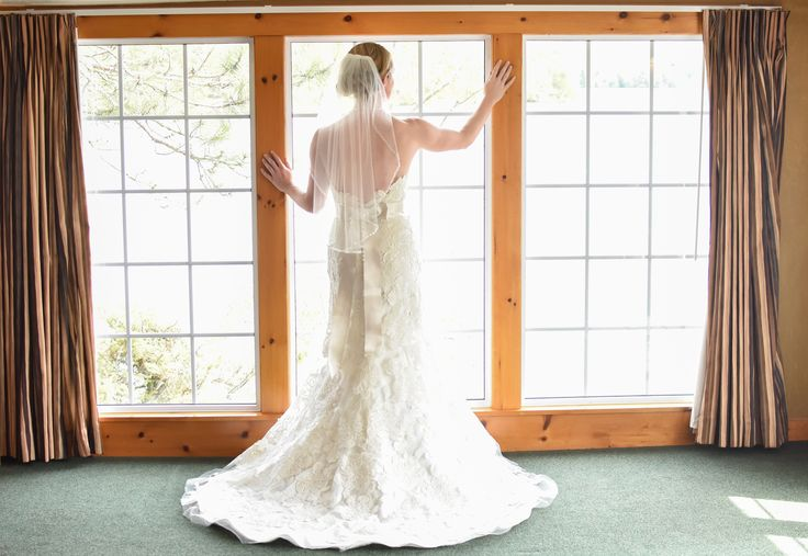 Back of the wedding dress, the bride admiring the view