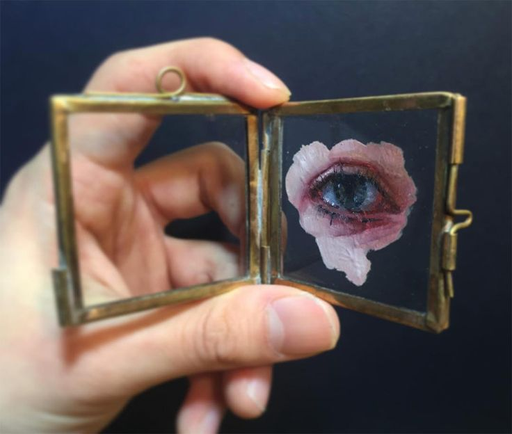 """As part of this ongoing series, self-taught painter Henrik Uldalen has been creating depictions of eyes and mouths on glass. The oil paintings are an extension of his focus on classic figurative painting where he explores """"the dark sides of life, nihilism, existentialism, longing and loneliness, jux"""