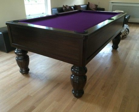 """7ft Emperor UK Pool Table manufactured in European oak with dark stain satin finish.  Large (7"""") turned fluted leg (barrel style)  Black leather pockets and purple cloth.  Shop here: http://www.snookerandpooltablecompany.com/pool-tables/uk-pool-tables/modern-bespoke-uk-pool/emperor-uk-pool-table-fluted-barrel-leg.html"""
